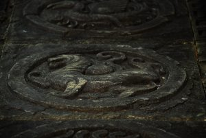 Close up of stone floor, dragon lion