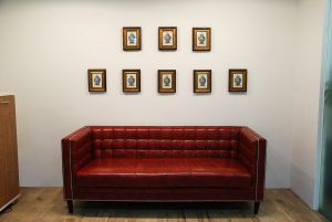 Red leather sofa with wall art