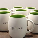 Image of cups with Julian Communication logo