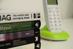 Closeup design books and phone